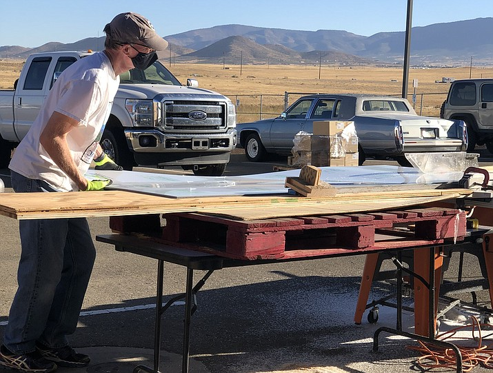 HUSD Superintendent John Pothast begins crafting the Plexiglass sheets into one of the 3,200 dividers to be installed in 10 district schools for reopening day on Monday, Oct. 19. (HUSD/Courtesy)