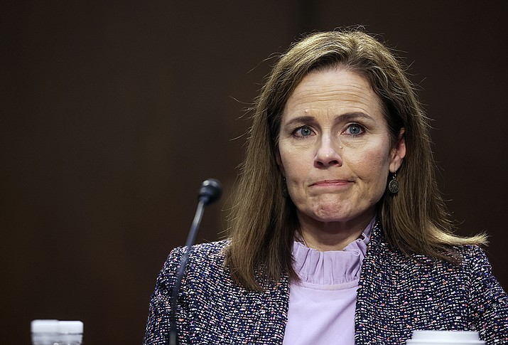 Supreme Court nominee Amy Coney Barrett departs after the third day of her confirmation hearings before the Senate Judiciary Committee on Capitol Hill in Washington, Wednesday, Oct. 14, 2020. (Jonathan Ernst/Pool via AP)