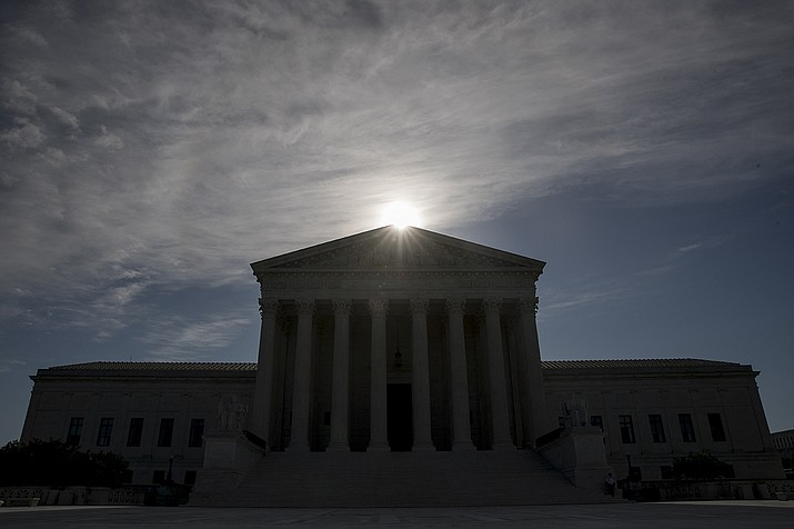This May 4, 2020, file photo shows the Supreme Court building in Washington. Controversial Trump administration policies on the census, asylum seekers and the border wall, held illegal by lower courts, are on the Supreme Court's agenda Friday, Oct. 16, 2020. Andrew Harnik, AP File)