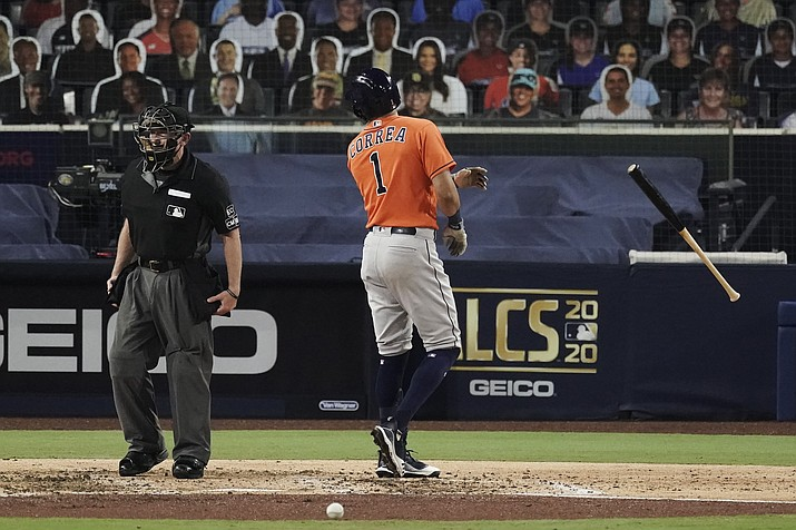Houston Astros Carlos Correa tosses his bat and has words with home plate umpire Lance Barksdale after striking out during the fourth inning in Game 7 of a baseball American League Championship Series, Saturday, Oct. 17, 2020, in San Diego. (Jae C. Hong/AP)