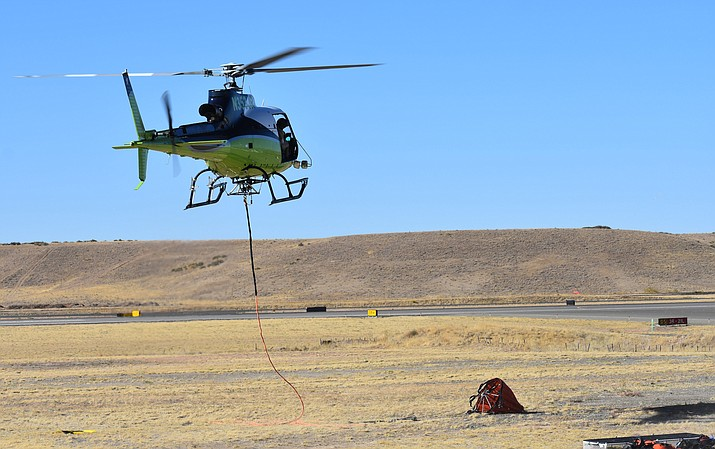 A helicopter prepares to take off with a water bucket at the Prescott Airport on Saturday, Oct. 17, 2020, as part of the air attack on the Horse Fire near Crown King. (Richard Haddad/Courier)
