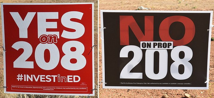 Campaign signs in the Prescott area urge positions on Proposition 208 without giving details. The ballot measure would tax people making more than $250,000 to help pay for education in Arizona. (Jesse Bertel/Courier)