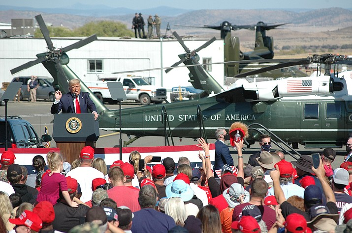 President Donald Trump gestures to the crowd during his nearly two-hour rally at Prescott Regional Airport on Monday, Oct. 19, 2020, to continue drumming up support for his 2020 re-election bid. An estimated 15,000 people packed into the airport to see Trump. (Doug Cook/Courier)