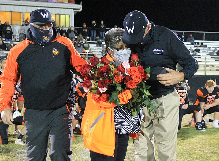 Vikings coaches Tad Wygal and Jeff Brownlee congratulate team nurse Nell Brown on her retirement. Brown retired from nursing after serving the team and Williams community for the past 45 years. (Wendy Howell/WGCN)