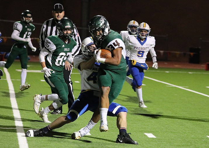 A Prescott defensive player attempts to bring down Flagstaff's Luis Jaramillo (34) on Friday, Oct. 23, 2020. The Badgers forced four Eagle turnovers and won 38-28. It was their first win of the season. (Arizona Daily Sun/Courtesy)