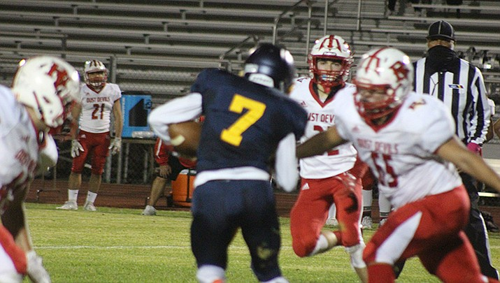 Kingman quarterback Gabe Imus runs the ball against River Valley on Friday, Oct. 23. (Photo by Casey Jones/Kingman Miner)