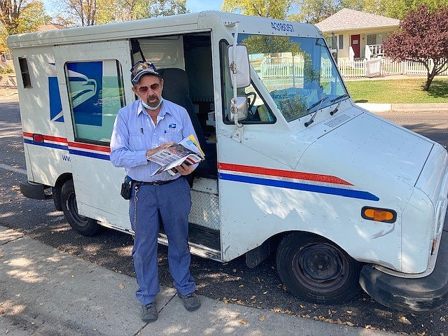 Postal carrier David Hyslip prepares to deliver some mail to a longtime Prescott resident on Mt. Vernon Avenue Thursday, Oct. 22, 2020. Hyslip, 71, has worked for the U.S. Postal Service in Prescott for nearly five decades.