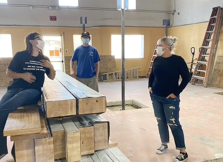 CCJ Executive Director Jessi Hans (far left) talks with Human Resources and Finance Director Tasha Rosander (center) and maintenance and facilities staff Cameron Lenocker (right) about the renovations. (Nanci Hutson/Courier)