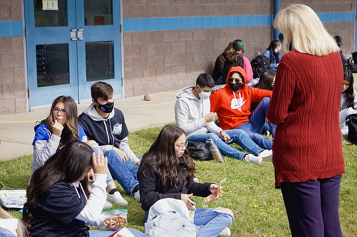 Chino Valley High School Principal Heidi Wolf, right, makes sure students are following safety guidelines during lunch time on the district's first day of full in-person instruction on Monday, Oct. 26, 2020, in Chino Valley. (Aaron Valdez/Review)
