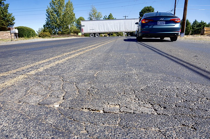 This photo shows cracks on the road near the intersection of Road 3 North and Road 1 West right outside the Chino Valley Public Works Department on Thursday, Oct. 1, 2020. (Aaron Valdez/Review)