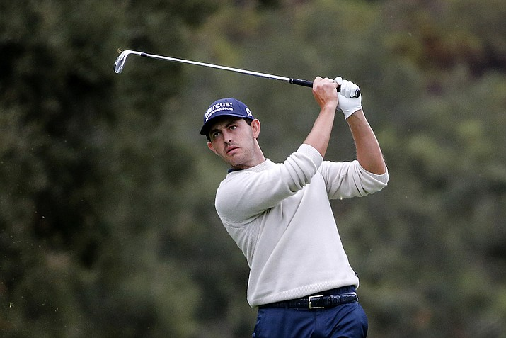 Patrick Cantlay watches his shot from the 18th fairway during the final round of the Zozo Championship golf tournament Sunday, Oct. 25, 2020, in Thousand Oaks, Calif. (Ringo H.W. Chiu/AP)