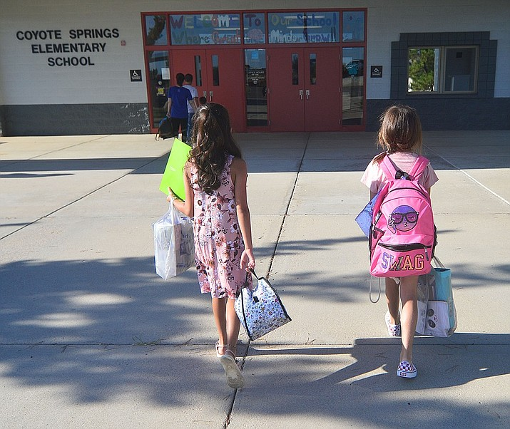 In this file photo, Coyote Springs Elementary School students attend their first day of school Monday, August 5, 2019, in Prescott Valley. Over the course of the next year, a new sidewalk will be built on the east side of Cattletrack Road, including a dogleg to Coyote Springs Elementary, to improve student safety. (Courier file)