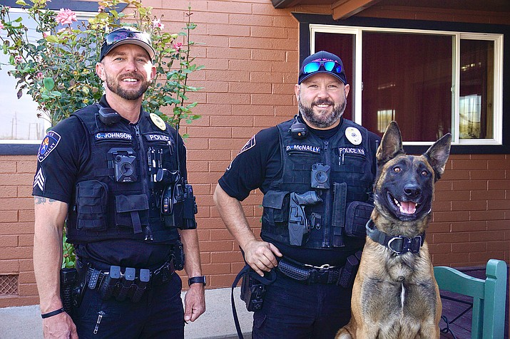 Chino Valley Police Department officer Cody Johnson, left, Dave McNally and his K9 partner Lisko stand outside El Paraiso Mexican-Italian Restaurant during Save a Cop night on Wednesday, Oct. 21, 2020, in Chino Valley. (Aaron Valdez/Review)