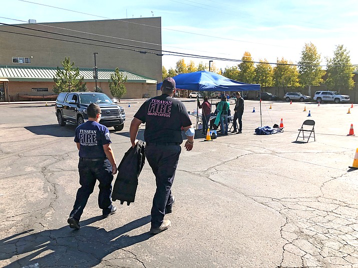 Heather Plytas and Ray D'Albini of Tusayan Fire District help with COVID-19 testing at the parking lot in the Imax Theater Oct. 22. (Photo/Tusayan Fire District)