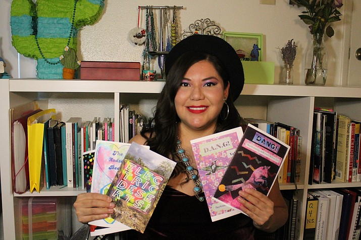 Amber McCrary holds up zines and a chapter book she created. McCrary hopes to open an Indigenous-owned publishing press called Abalone Mountain Press, which will spotlight Native voices. (Photo courtesy of Amber McCrary)