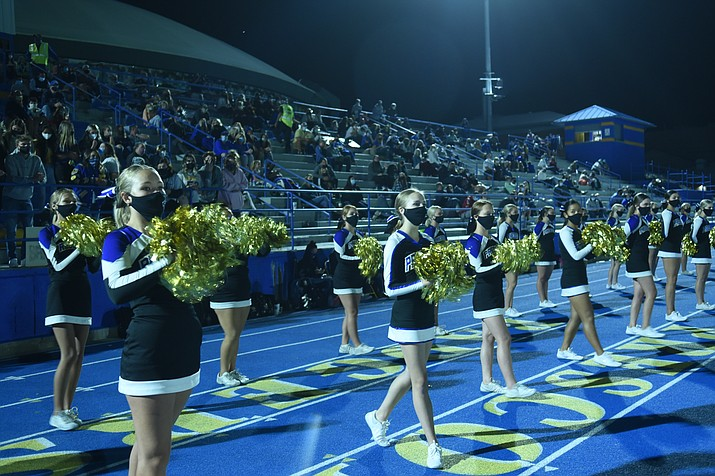 The Prescott cheerleaders lead a sparse COVID-19 crowd as Prescott hosted Apache Junction on Oct. 9, 2020. The Badgers welcome Mohave on Friday, Oct. 30. Kickoff is set for 7 p.m. (Jesse Bertel/Courier, file)