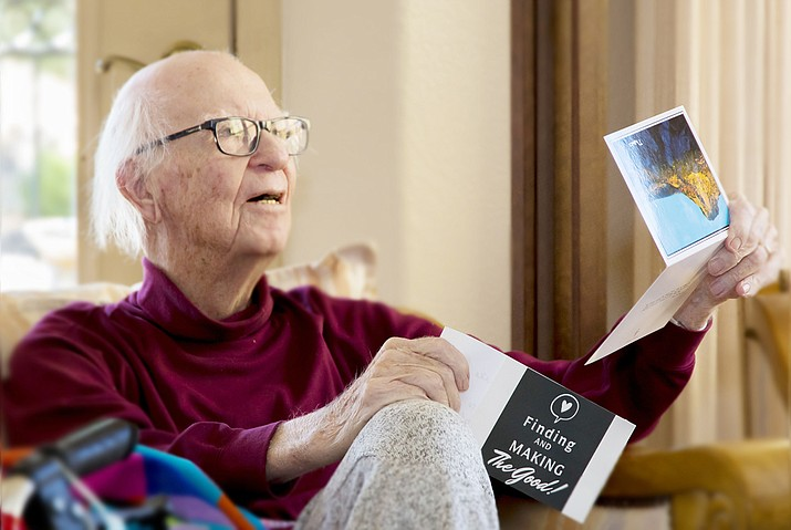 """Dr. Ron Barnes reads a card presented with a special awared to him by the """"Finding & Making the Good"""" organization. (Andrew McQuality/Courtesy)"""