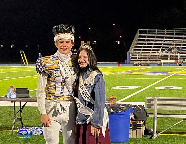 Prescott football player Brayden Nelson stands with Maddie Young after being named the 2020 Homecoming king and queen for Prescott High School on Friday, Oct. 30, 2020. The Badgers beat Mohave 55-0. (Missy Townsend/Courtesy)