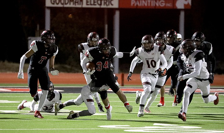 Coconino running back Zach Bennett (34) avoids multiple tacklers from Bradshaw Mountain on Friday, Oct. 30, 2020. Bennett scored three touchdowns in a 38-14 win for the Panthers, which are now 5-0 on the season. Bradshaw Mountain drops to 3-2 overall. (Arizona Daily Sun/Courtesy)
