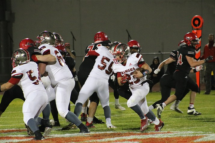 Angelo Alvarez looks for running roon in Friday's loss to Lee Williams in Kingman. The Marauders's 51-26 loss was their third consecutive, and they'll host Coconino on Friday in their final home game of 2020. Travis Rains/Kingman Daily Miner