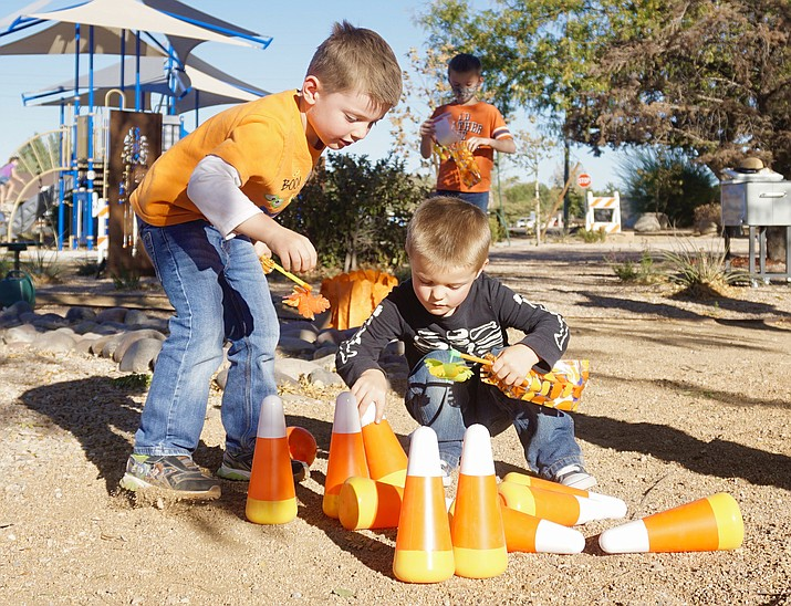 A couple of boys complete the bowling pins task at one of the storywalk stations during the Chino Valley Public Library's Pumpkin Patch Storywalk on Thursday, Oct. 29, 2020, at Memory Park in Chino Valley. (Aaron Valdez/Review)