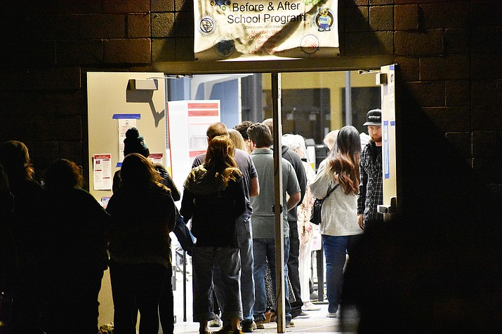Residents stand in line well after 7 p.m. at a school in Prescott Valley to cast their vote during Election Day on Tuesday, Nov. 3, 2020. (Richard Haddad/Courier)