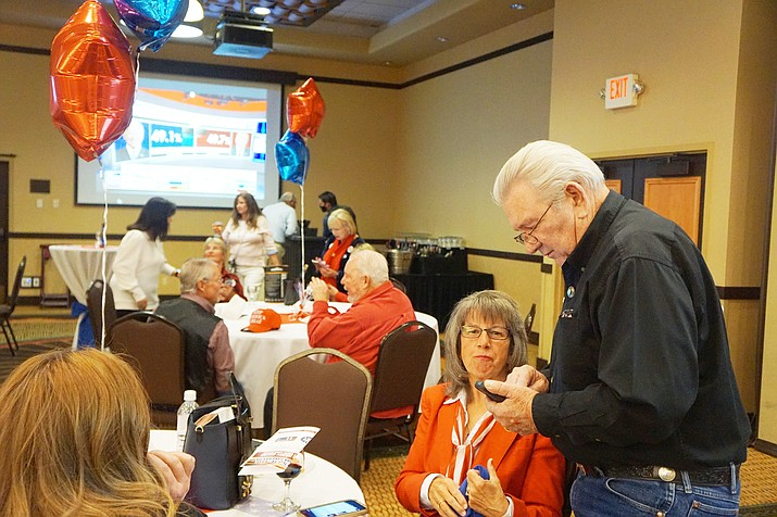Craig Brown, right, and Marry Mallory look at election results on a phone at the Prescott Resort on Tuesday, Nov. 3, 2020. (Cindy Barks/Courier)