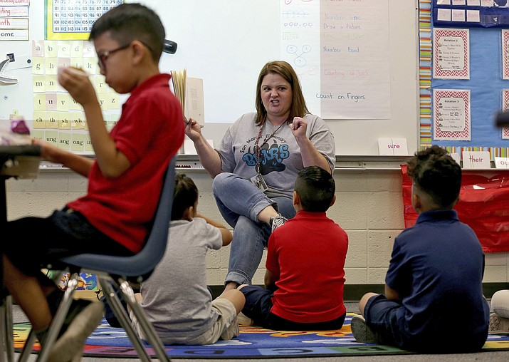Public schools in Arizona that have weathered a decade of funding cuts with only partial restoration could see a big infusion of cash if a ballot measure backed by teachers and advocacy groups passes in November, but opponents say Proposition 208 will hurt the economy and only bring partial relief. (Matt York/AP, file)