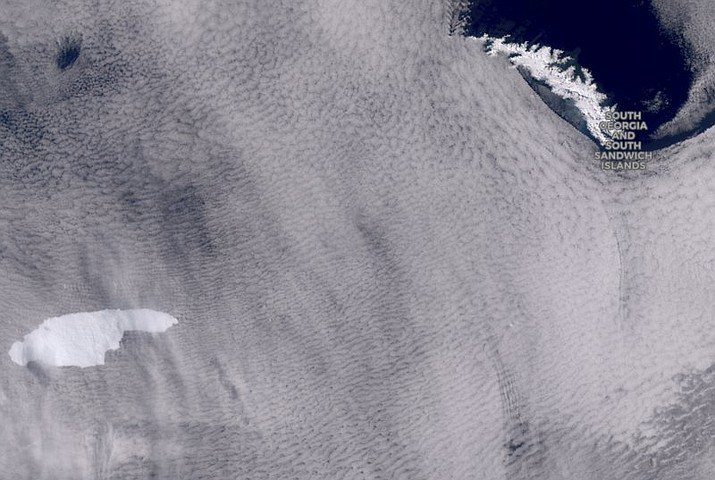In this graphic provided by the European Space Agency containing modified Copernicus Sentinel data (2020), processed by the Sentinel Hub, shows an iceberg floating towards the sub-Antarctic island of South Georgia. The iceberg the size of the U.S. state of Delaware is raising fears it could indirectly endanger young wildlife. The British Antarctic Survey said Wednesday, Nov. 4, 2020 it is concerned the iceberg may run aground near the island and prevent land-based marine predators from reaching food supplies and returning to their offspring. (European Space Agency containing modified Copernicus Sentinel data (2020), processed by the Sentinel Hub via AP)