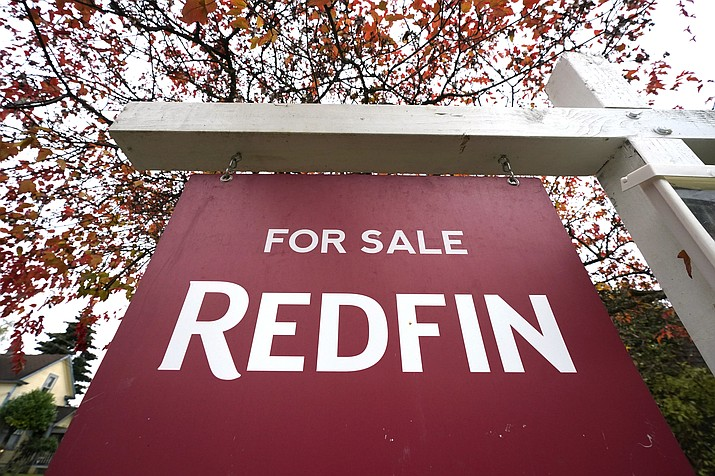 "A Redfin ""for sale"" sign stands in front of a house Wednesday, Oct. 28, 2020, in Seattle. Several fair housing organizations accused Redfin of systematic racial discrimination in a lawsuit Thursday, saying the online real estate broker offers fewer services to homebuyers and sellers in minority communities, a type of ""digital redlining"" that has depressed home values and exacerbated historic injustice in the housing market. (Elaine Thompson/AP)"