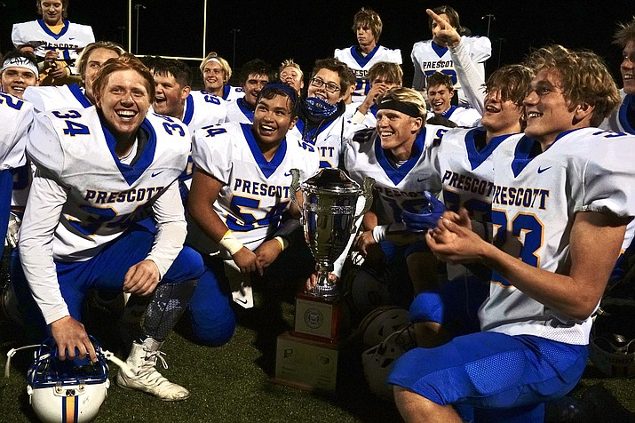 Prescott football celebrates with the Esse Quam Videri trophy after defeating cross-town rivals Bradshaw Mountain 32-10 in a game on Friday, Nov. 6, 2020, at Bob Pavlich Field in Prescott Valley. (Aaron Valdez/Courier)