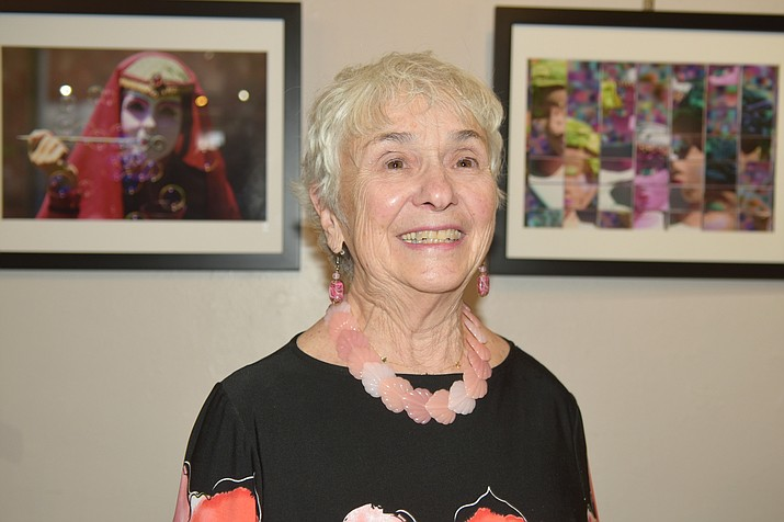 Arlene Minuskin, a photographer from Prescott who was awarded the 2020 Governor's Arts Award in the Artist category representing the northwest Arizona region, stands in front of two of her photographs on display at the Prescott Center for the Arts Gallery & Gift Shop, on Friday, October 29, 2020. (Jesse Bertel/Courier)