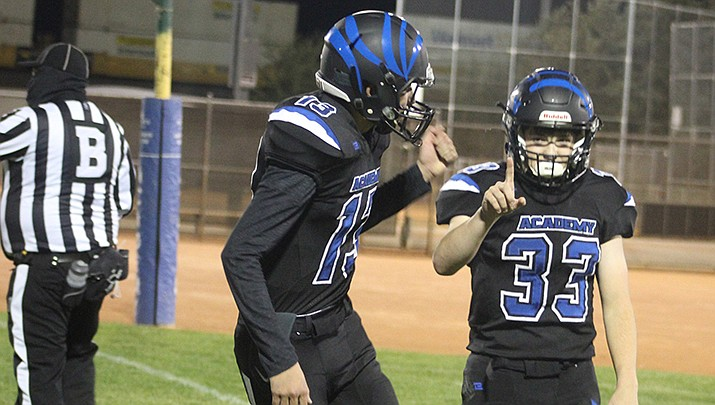 Kingman Academy High School running back Isaac Carter, right, celebrates his 45-yard touchdown run with teammate Jose Sainz. The Tigers beat St. John Paul II 54-6 on Friday, Nov. 6. (Photo by Casey Jones/Kingman Miner)