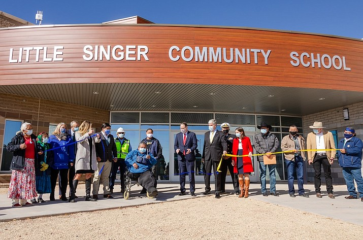 Little Singer Community School Board President Leslie Williams cuts the ribbon at the new Little Singer Community School facility in Birdsprings, Arizona Oct. 28. Council Delegate Thomas Walker, Jr., federal officials, construction personnel and community leaders were present for the ceremony and dedication of the school. (Photo/Navajo Nation Office of the Speaker)