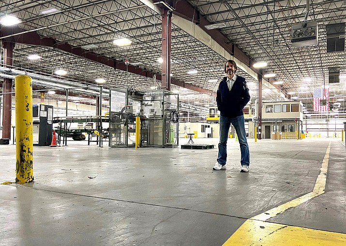 Jason Rosamond, chairman and founder of Good Earth Power AZ and NewLife Forest Products, stands in the future home of the Windfall Sawmill. Good Earth recently purchased a 425,000-square-foot warehouse in Bellemont for the new mill. (Wendy Howell/WGCN)