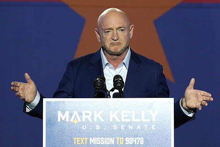 Mark Kelly, Arizona Democratic candidate for U.S. Senate, gestures as he speaks at an election night event Tuesday, Nov. 3, 2020 in Tucson, Ariz. (AP Photo/Ross D. Franklin)