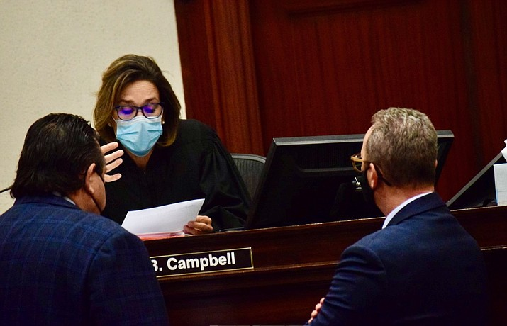 Judge Jennifer B. Campbell talks with defense attorney Alex Gonzalez, left, and Yavapai County prosecutor Steven Young during the murder trial of Cecilio Cruz in Prescott. The jury began deliberations in the 23-year-old case at 2 p.m. Thursday. VVN/Jason W. Brooks