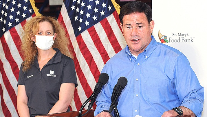 Arizona Gov. Doug Ducey, responding to a surge in virus cases, has extended an order requiring that detailed data be reported to the state by hospitals, labs and other health care facilities. (Photo by Howard Fischer/For the Miner)