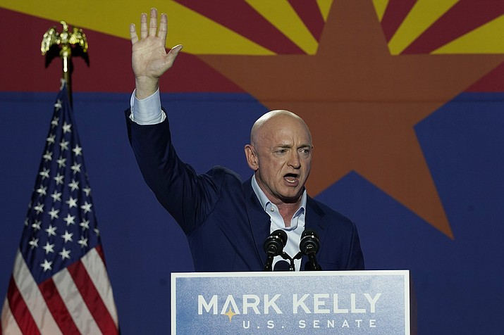 Mark Kelly, Arizona Democratic candidate for U.S. Senate, waves to supporters as he speaks during an election night event Tuesday, Nov. 3, 2020 in Tucson, Ariz. (Ross D. Franklin/AP)