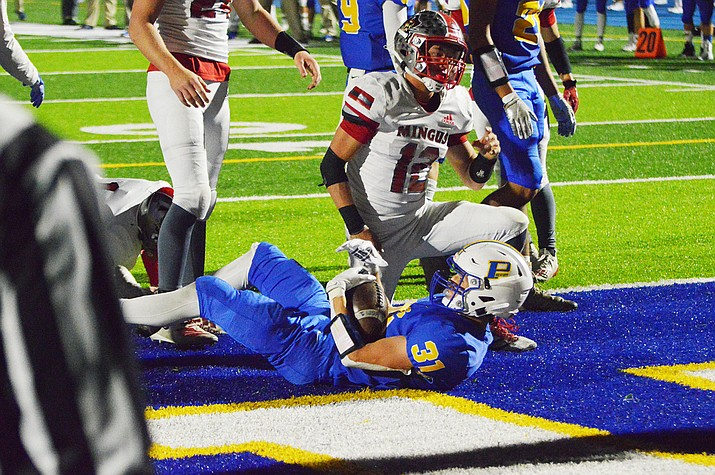Prescott running back Nathan Wright (31) scores a touchdown in the first quarter, his first of three on the night. The Badgers beat Mingus 43-35 on Friday, Nov. 13, 2020, in Prescott. (Brian M. Bergner Jr./Courier)