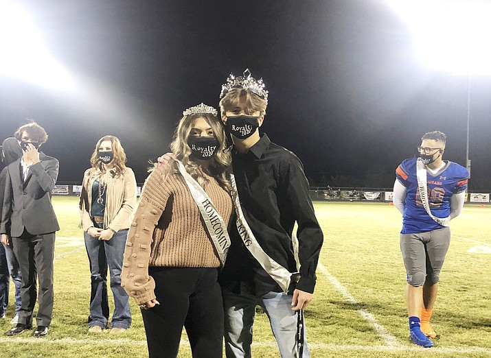 Cassandra Green, left, and king Jason Ehlert pose for a photo after being selected as Chino Valley's 2020 Homecoming king and queen at the Homecoming Game Friday, Nov. 13, 2020.