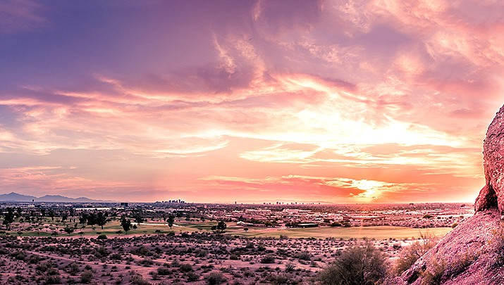 Phoenix has set another heat record in a record-setting year. A sunset over Phoenix is shown. (Adobe image)
