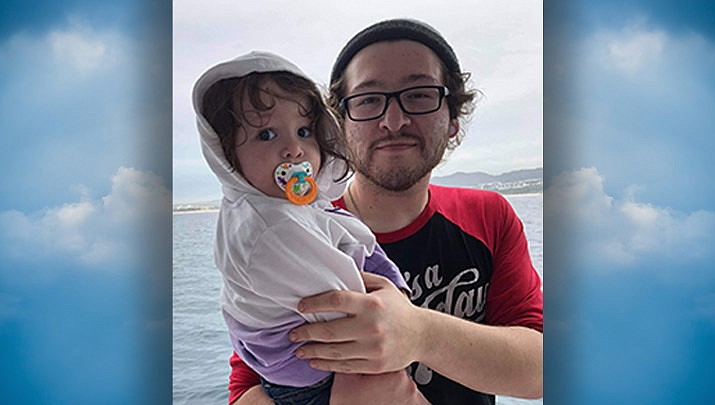 Nicholas Edward Franzen, 26, with his daughter.