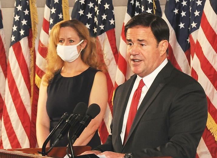 Gov. Doug Ducey explains why he's not implementing new restrictions even as he concedes Wednesday, Nov. 18, 2020, that the rate of COVID-19 infection in Arizona is on the rise. With him is state health chief Cara Christ. (Howard Fischer/Capitol Media Services)
