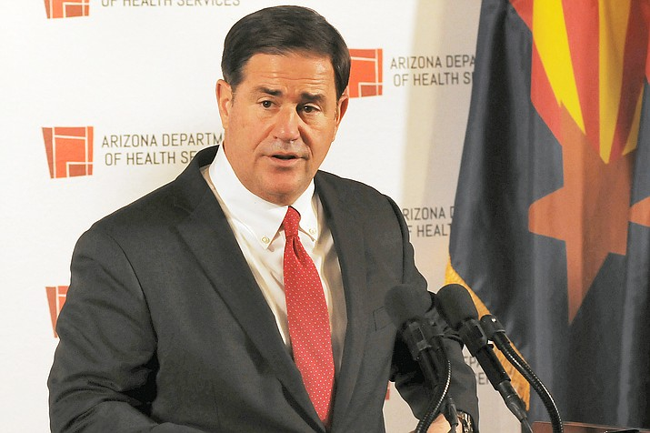 Gov. Doug Ducey refuses to condemn Trump supporters who contend that the apparent vote by Arizonans for Joe Biden for president is the result of fraud in the election. (Capitol Media Services photo by Howard Fischer)