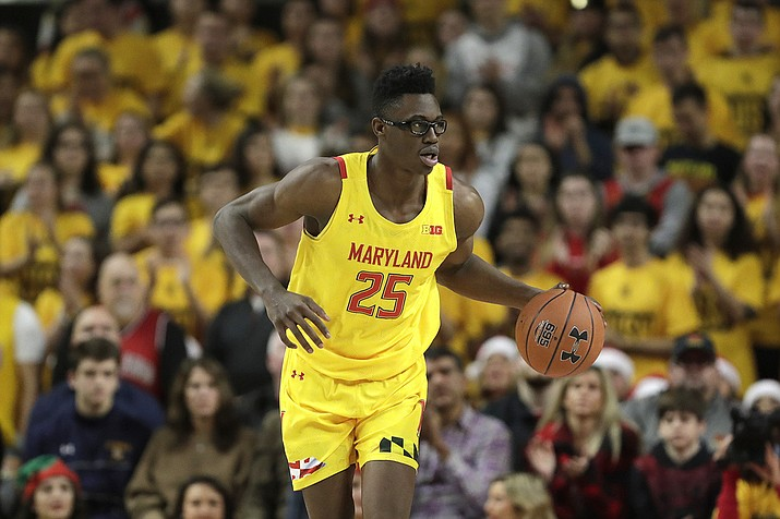 In this Dec. 7, 2019, file photo, Maryland forward Jalen Smith dribbles up court against Illinois during the second half of an NCAA college basketball game in College Park, Md. Smith was selected by the Phoenix Suns in the NBA draft Wednesday, Nov. 18, 2020. (Julio Cortez, AP File)