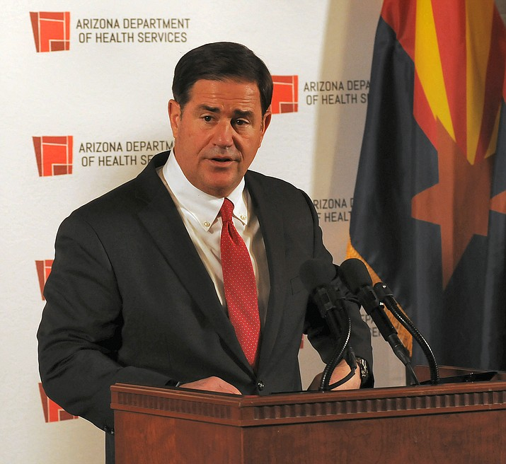 Gov. Doug Ducey refuses to condemn Trump supporters who contend that the apparent vote by Arizonans for Joe Biden for president is the result of fraud in the election. (Howard Fischer/Capitol Media Services)