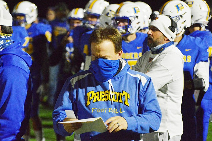 Prescott football head coach Cody Collett looks at his play sheet on the sidelines Friday, Nov. 13, 2020. The Badgers earned a spot in the 4A state play-in round, but were turned away by No. 4-ranked Cactus by a final score of 59-7 on Friday, Nov. 20, 2020, in Glendale. (Brian M. Bergner Jr./Courier, file)