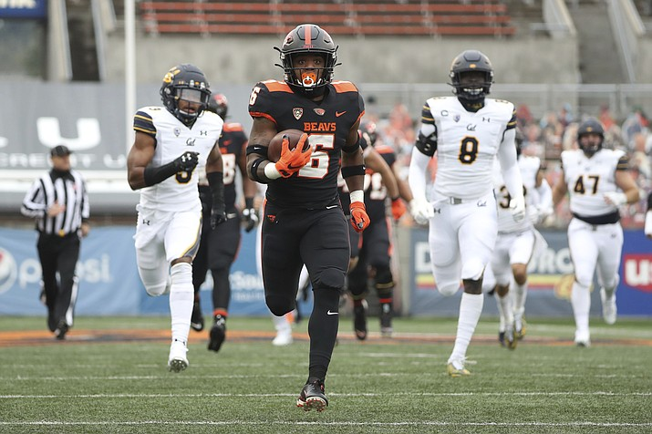 Oregon State running back Jermar Jefferson (6) runs 75-yards to score a touchdown on the first play of an NCAA college football game against California in Corvallis, Ore., Saturday, Nov. 21, 2020. (Amanda Loman/AP)