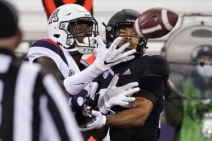 Arizona's Ma'jon Wright catches an 11-yard touchdown pass as Washington's Julius Irvin, right, defends during the second half of an NCAA college football game Saturday, Nov. 21, 2020, in Seattle. (Elaine Thompson/AP)